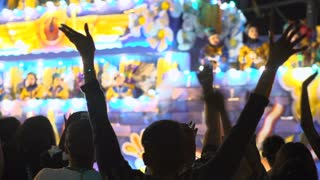 Crowd with hands in air during Endymion parade