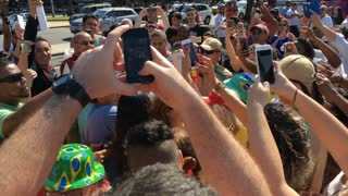Crowds of people posing with Diogo Nogueira during 2016 Olympics 4k