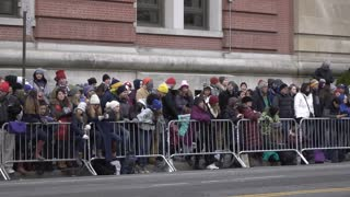 Crowds of people waiting for Parade in slow motion