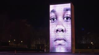 Crown Fountain art exhibit in downtown Millennium Park Chicago at night 4k