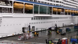 Cruise ship being loaded at dock