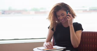 Cute young girl laughing while on cell phone talking 4k