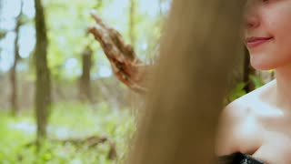 Cute Young girl looking around in woods 4k