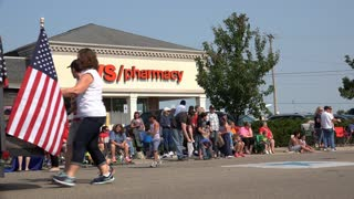 CVS Pharmacy in background of July 4th Parade 4k