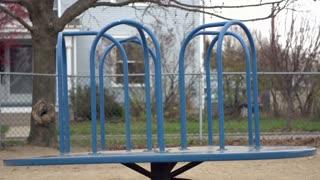 Damaged Merry go round in playground
