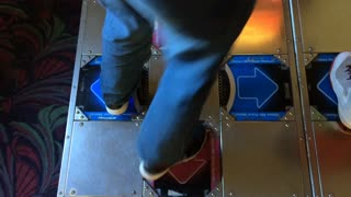 Dancing arcade game played by person