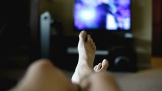 Dancing feet watching Television