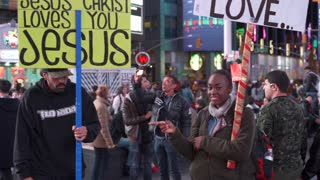 Dancing man with Jesus Christ Loves You sign in Times Square 4k