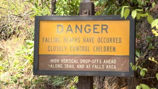 Danger falling deaths sign on nature hike 4k