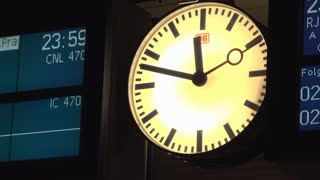 DB clock at railway station in Mannheim Germany 4k