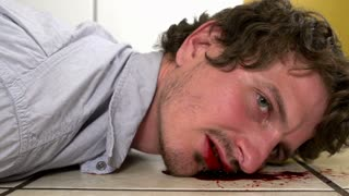Dead man dragged across kitchen tile