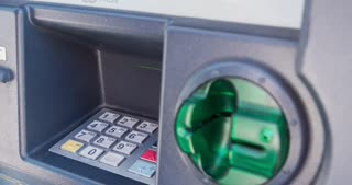 Debit card inserted into ATM machine 4k