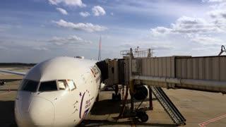 Delta Airlines airplane at terminal gate in Atlanta Georgia 4k