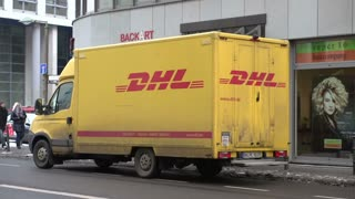 DHL delivery truck sitting on downtown street of Berlin Germany