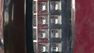 Dialing Number on Payphone