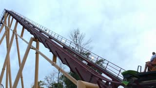 Diamondback rollercoaster going up first hill