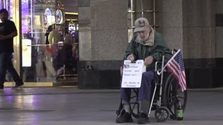 Disabled Vet in wheelchair with sign asking for money 4k