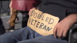 Disabled Veteran sign held by man in wheel chair 4k