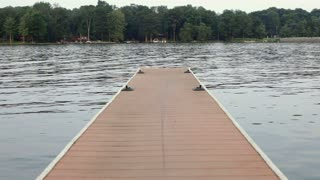 Dock with Boat in Background Pulling Tube