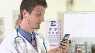 Doctor having video call using cell phone in office