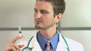 Doctor prepares needle then injects into patient