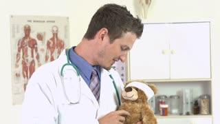 Doctor pulls gun on teddy bear