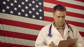 Doctor with clipboard and american flag background