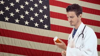 Doctor with pills on American Flag background