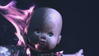 Doll baby head burning