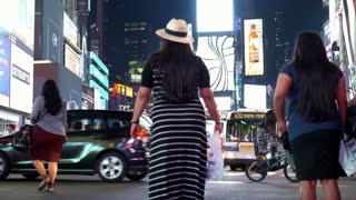 Downtown New York City Times Square with pedestrians and traffic 4k