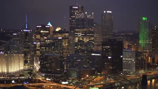 Downtown Pittsburgh establishing shot at night building overview