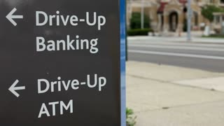 Drive up bank and ATM sign by Street