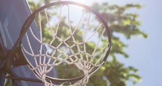 Driveway basketball hoop with spiderwebs on net 4k