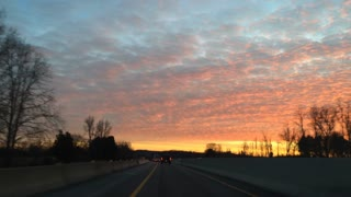 Driving through construction on highway into sunset