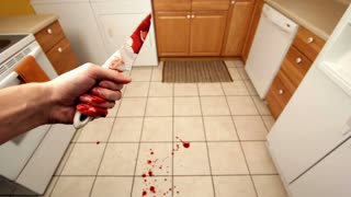 Dropping knife in kitchen with blood on ground