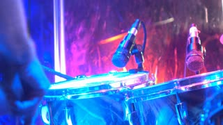 Drummer playing drums at concert 4k