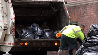 DSNY loading trash bags into garbage truck 4k