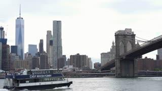East River Ferry of New York City departing towards Brooklyn Bridge 4k