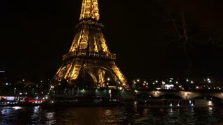 Eiffel tower at night in Paris tilt