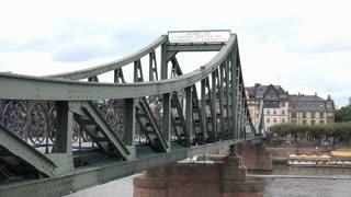 Eisener Steg bridge across Main river in Frankfurt Germany 4k