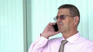 Elderly Businessman on cellular phone