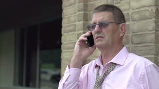 Elderly businessman talking on cell phone