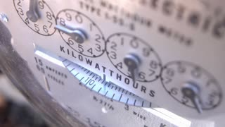 Electrical meter dial spinning as electricity is used 4k
