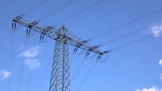 Electrical power lines with blue sky background 4k