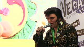 Elvis singing into microphone on stage