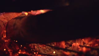 Ember stirred in fire pit slow motion