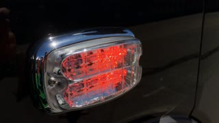 Emergency flashing light on side of police vehicle 4k