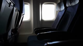 Empty chairs in airplane flight
