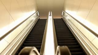 Empty Escalators in lit hall