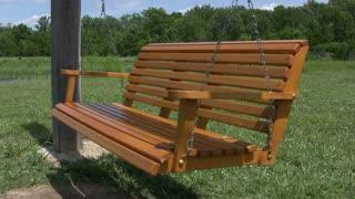 Empty hanging bench swing